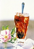 A Glass of Iced Coffee with a Spoon and a Flower