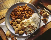 Shelled Whole Flaked and Ground Almonds on a Plate