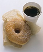 Sugared Donut with a Cup of Coffee