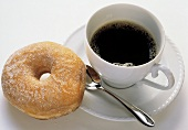 Cup of Coffee on a Saucer with a Donut