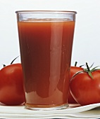 A Glass of Tomato Juice with Tomatoes