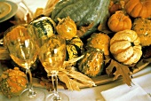 Assorted Gourds Centerpiece with Wine Glasses