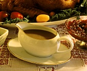 Brown sauce in sauce boat & cranberry sauce for roast turkey