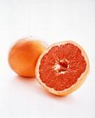 A Whole Grapefruit with a Half of a Grapefruit