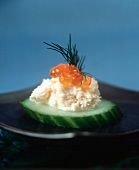 Salmon Mousse with Salmon Caviar on a Slice of Cucumber