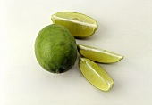 A Whole Key Lime with Three Lime Wedges