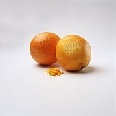 Two Oranges;One with Part of The Peel grated