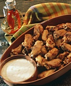 Buffalo Wings in a Serving Bowl; Dip