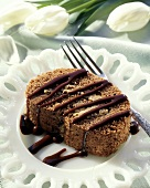 A Slice of Chocolate Angel Cake with Chocolate Sauce