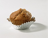 A bran muffin in a case