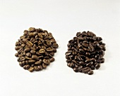 Two Piles of Coffee Beans; High Roast and Mocha Beans