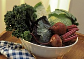 Assorted Leaf Vegetables and Red Beets in a Bowl