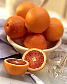 A Blood Orange Cut in Half; A Bowl of Oranges
