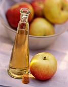 Apple Vinegar in a Bottle with an Apple