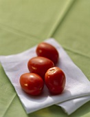 Plum Tomatoes on a White Cloth Napkin