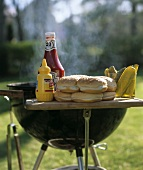 Grill Outdoors with Condiments and Rolls