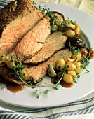 Partially Sliced Veal Roast with Onions and Mushrooms