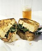 Grilled Steak Sandwich Cut in Half; Beer