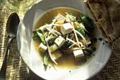 A Bowl of Tofu Soup; Pita Bread
