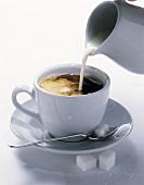 Cream Pouring into Coffee