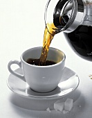 Coffee Pouring into a Cup From a Coffee Pot