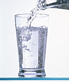 Seltzer Water Pouring into a Glass