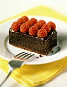 A Slice of Chocolate Fudge Cake with Raspberries