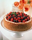 Whole Cheesecake with Berry Sauce Blueberries and Raspberries