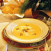A Serving of Squash Soup on a Christmas Table