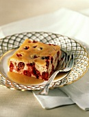A Slice of Cranberry Cake in Cinnamon Sauce