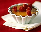 Serving of Creme Brulee with Raspberries
