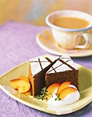 Two Pieces of Chocolate Cake with Powdered Sugar; Fruit