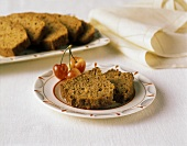 Two Slices of Carrot Bread on a Plate; Cherries