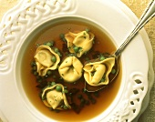 Tortellini in brodo (Clear soup with tortellini and peas)