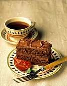 A Slice of Chocolate Cake with a Strawberry; Coffee