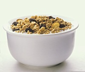 A Bowl of Granola Cereal with Rasisins and Almond Slivers