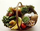 Fresh Produce in a Basket; Vegetables Bread Milk and Eggs