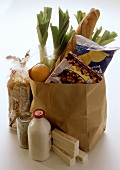 Fresh Produce in and Beside a Brown Paper Bag