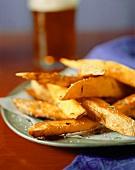 Herbed Steak Fries on a Plate; Salt