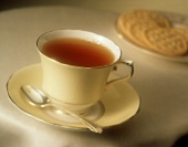 A Cup of Tea with Saucer and Spoon