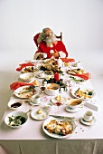 Santa Claus Sitting at the Head of the Table After Dinner