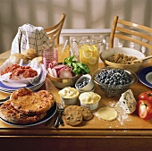 Assorted Prepared and Unprepared Foods on a Table