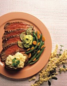 Sliced Flank Steak with Baked Potato and Green Beans