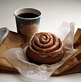 Cinnamon Bun with a Cup of Coffee