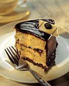 A Slice of Layered Yellow Cream Cake with Chocolate Frosting