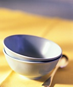 Empty Blue Bowls on a Yellow Cloth