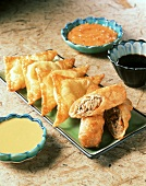 Egg Rolls on a Platter, Crab Rangoon and Three Sauces