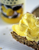 Lemon curd on slice of wholemeal bread