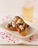 Crostini (Goat's cheese, peppers & olives on toasted bread)