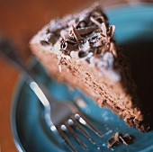 Slice of Mocha Cake Topped with Chocolate Curls